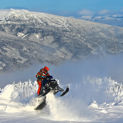 Ray Marak wheelies his sled in Smithers, B.C.