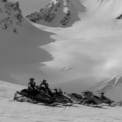 A group of snowmobilers on one of the picturesque snowmobile trails around smithers