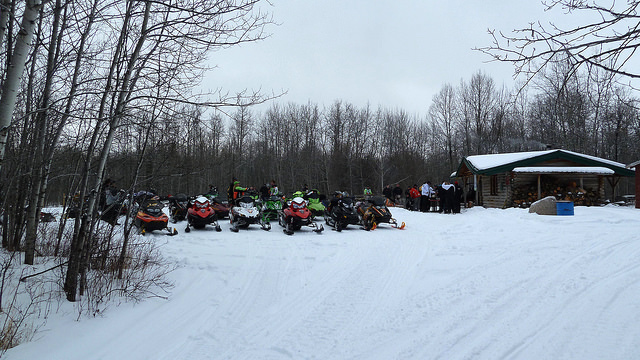 A group of sledders stopped for a lunch break at Bartles Cabin NW of Smoky Lake.