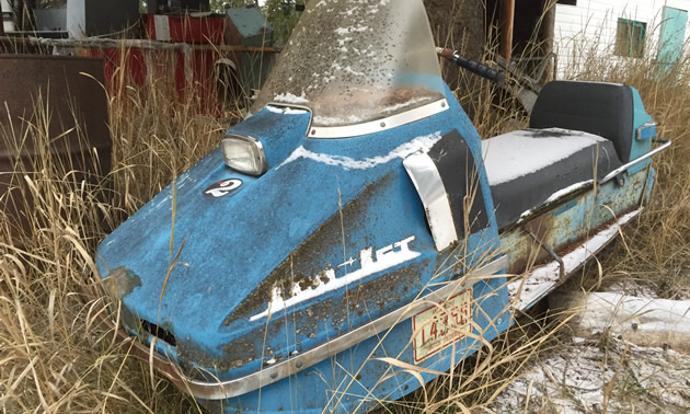 A vintage powder-blue Sno-Jet sled.