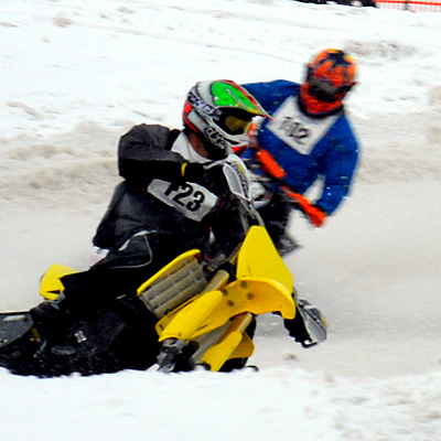 Snow bikes racing in motocross.