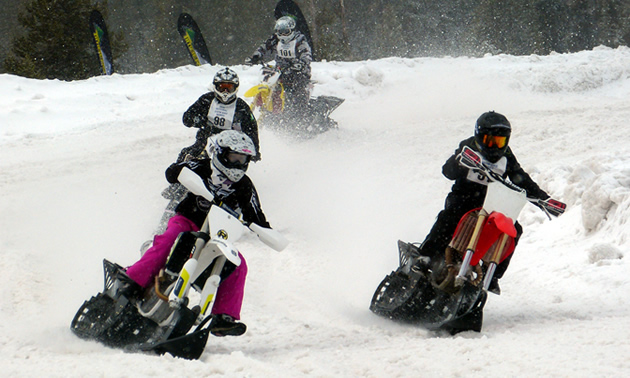 Two women snow bike racers going head to head in West Yellowstone.