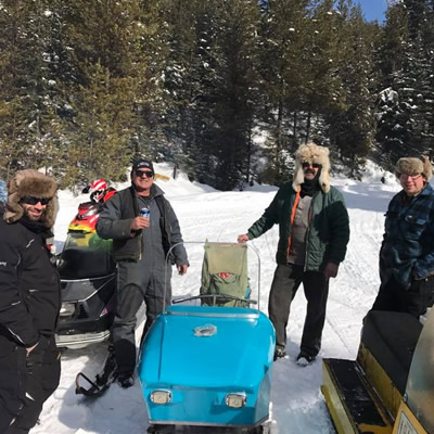 Ray Kelly (back right) and members of the Cranbrook Snowmobile Club proudly display the restored 1965 Snow King.