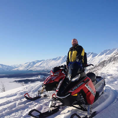 Scott Benda on a beautiful bluebird day of snowmobiling in Valdez, Alaska.