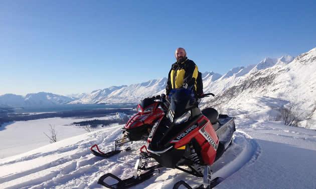 Scott Benda on a beautiful bluebird day of snowmobiling in Valdez, Alaska.