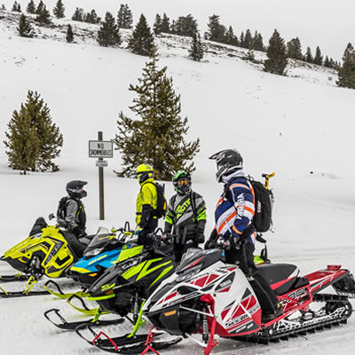 Group of snowmobilers getting ready to ride.