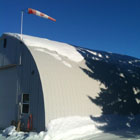 A Quonset hut with snow on it