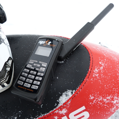 SPOT Global Phone on a snowmobile seat.