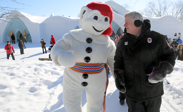 Stephen Harper with the carnival's mascot.