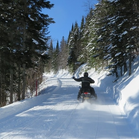 person riding on the snowmobile trails in St. Paul