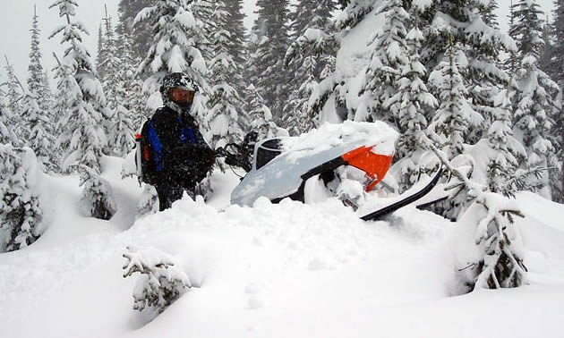 A snowmobiler from Fernie stuck on his sled.