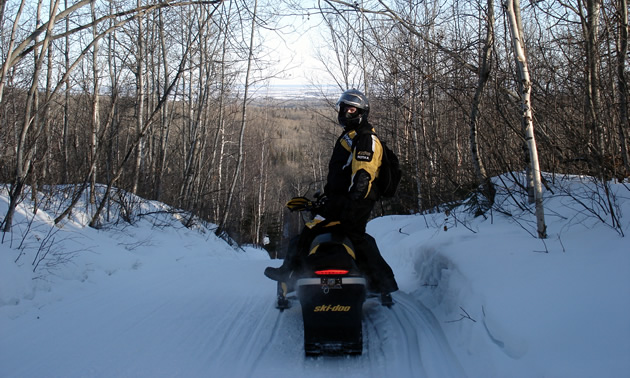 Sledder riding the trail in the Swan Valley.