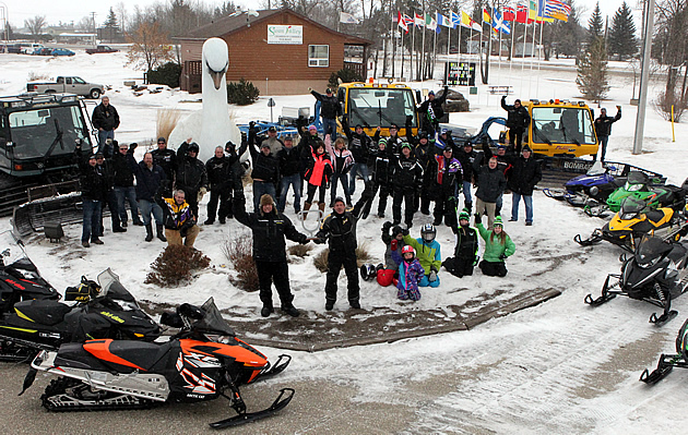 A gathering of snowmobilers in Swan Valley, Manitoba, as they celebrate their 2015 SledTown ShowDown championship.