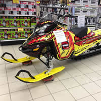A new 2015 snowmobile sitting in a grocery store.