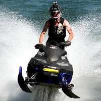 Taylor Fisk from MotoFist rides his sled across the water.