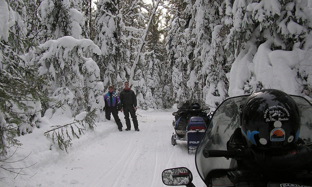 This is snowmobiler Robert Vipond's son, Ryan, with his wife, Shirley, on the trail between Wanless and The Pas. This area is known by locals as the Loppit trail.