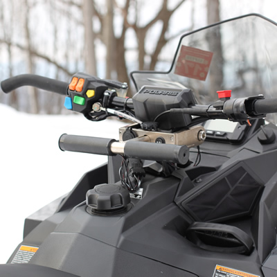 Miniature handlebars for kids on a Polaris snowmobile.