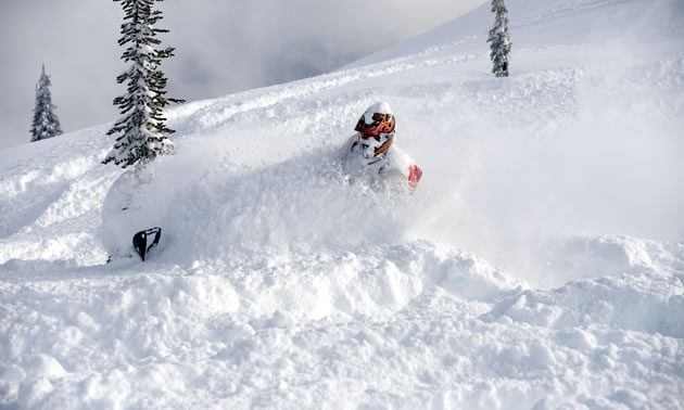 A snowmobiler slashes into the deep snow around Revelstoke.
