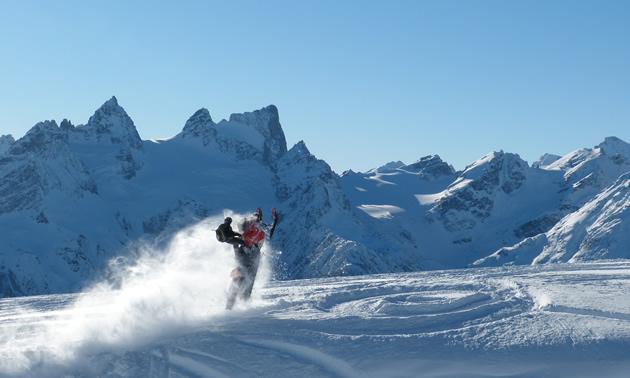 Snowmobiler hitting a wind lip in Radium.