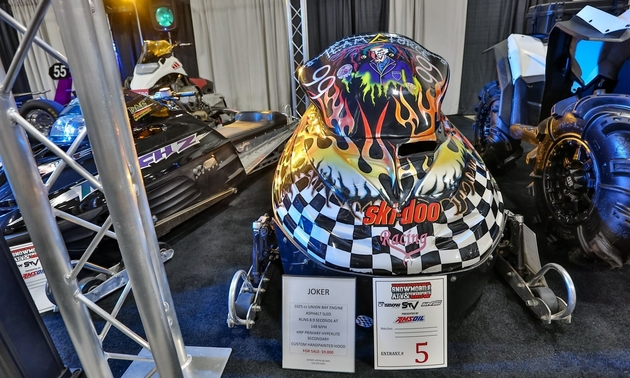 Vibrant snowmobiles on display