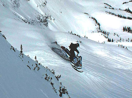 sledder riding down a slope