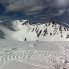 Scenic shot of mountains covered in snow.