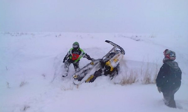 man pulling his sled out of snow