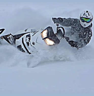 Travis Dauvin carving downhill after a fresh snowfall near Debden, SK.