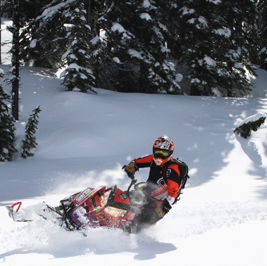 Trish Drinkle trying out her new shocks in the powder.