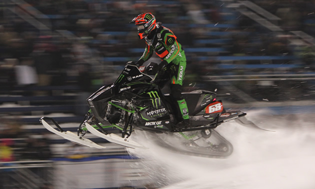 Tucker Hibbert powers past the audience in an Illinois snocross race.