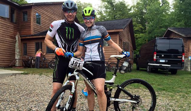 Tucker and Mandi Hibbert on a mountain bike.