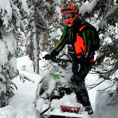 Tucker Hibbert on a mountain sled.