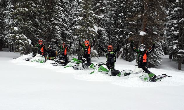 Team #68 Tucker Hibbert on sleds in the mountains.
