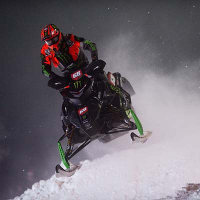 Tucker Hibbert on snowmobile.