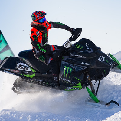 Tucker Hibbert racing on sled