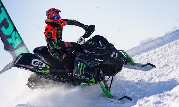 Tucker Hibbert racing on sled