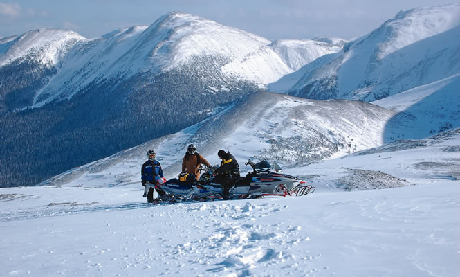 Group of snowmobilers in a field