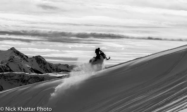 Erik Luzak hitting a booter on his snowmobile Turtle Mountain in Revelstoke.