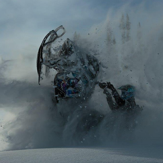 A sledder is shredding fresh powder in Chappell Creek in Valemount.