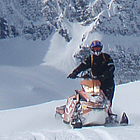 person on a sled in the mountains