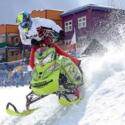 Morgan Gamache on a yellow Ski-Doo charging through Silver Star Ski Resort.