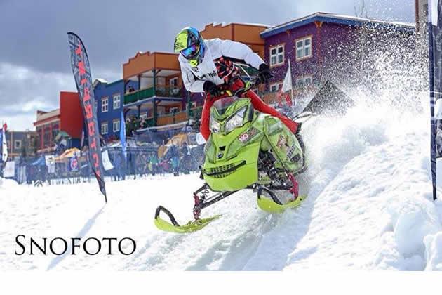 Morgan Gamache on a yellow Ski-Doo charging through Silver Star Ski Resort.