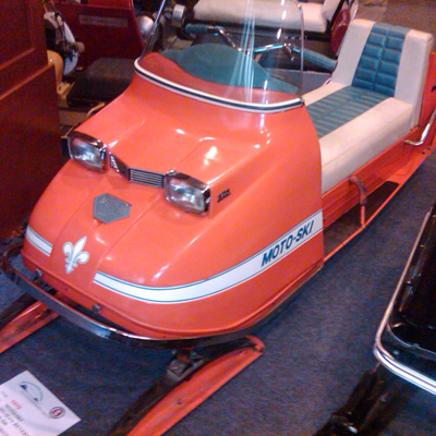 Picture of a restored Moto-Ski snowmobile. The colour is red.