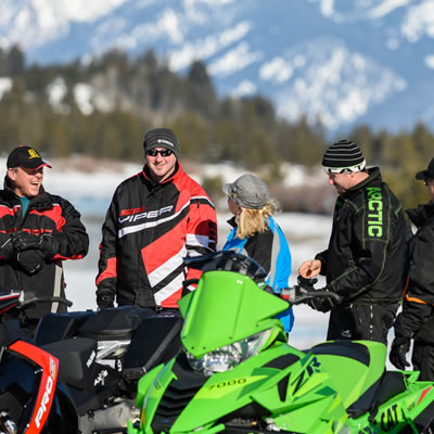 Group of snowmobilers getting ready to go out.