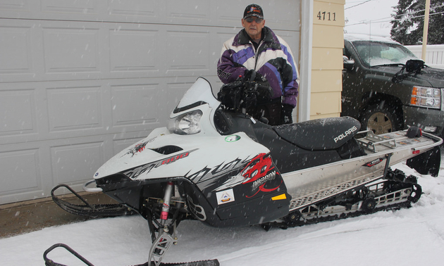 Standing in back of his ride, Cyril Lanctot, 81 years old, is still an active member of the Whitecourt Trailblazers and helps out wherever possible.