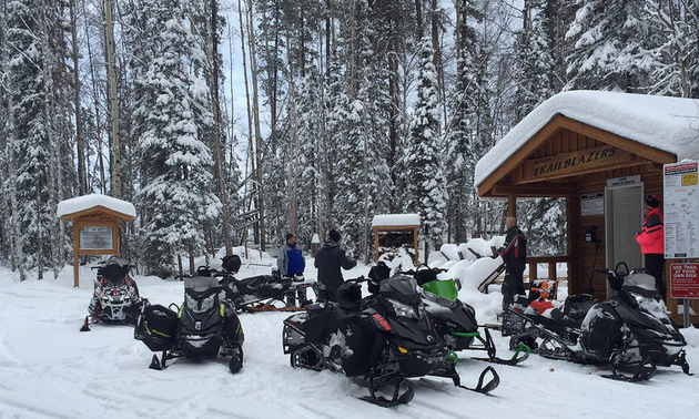 Pictured is one of the Whitecourt Trail Blazers' warm-up shelters with many sleds parked out front.