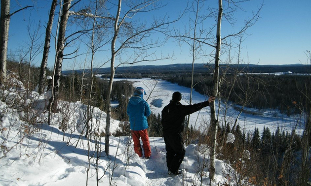 Barry Murphy and his son, Devon, are standing at The Athabasca lookout en route to the Carson Cabin.