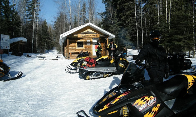 The local snowmobiling club keeps the trails in Whitecourt in great shape. Here, the Murphy family takes a break at the Carson cabin.
