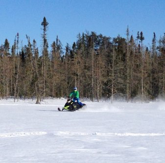 A snowmobiler in Whiteshell Provincial Park in Manitoba.