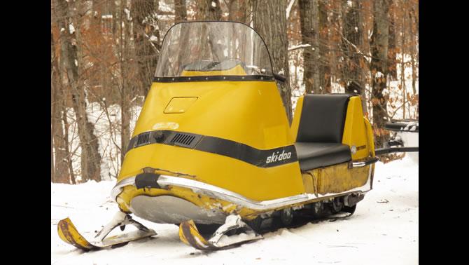 A vintage yellow Ski-Doo